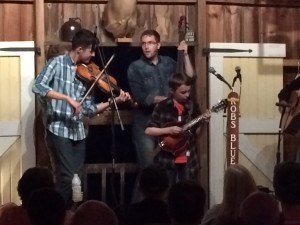 One of Patrick McAvinue's students plays the mandolin on stage.